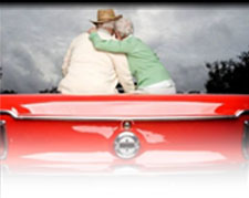 elderly couple in a car